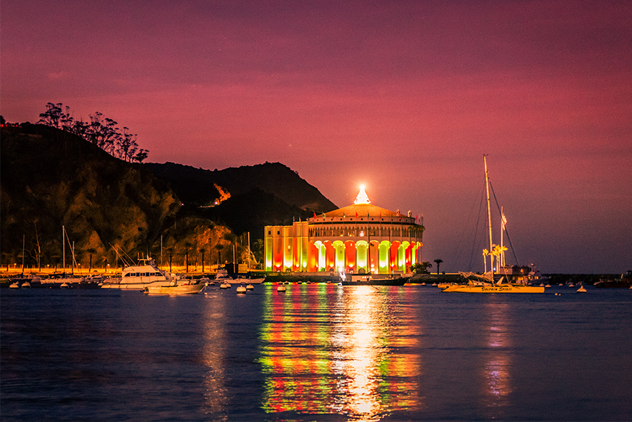 Sunset over Avalon Bay with holiday decorations on the Catalina Island Casino