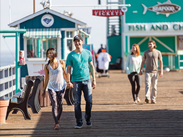 Happy couple walking down Green Pleasure Pier