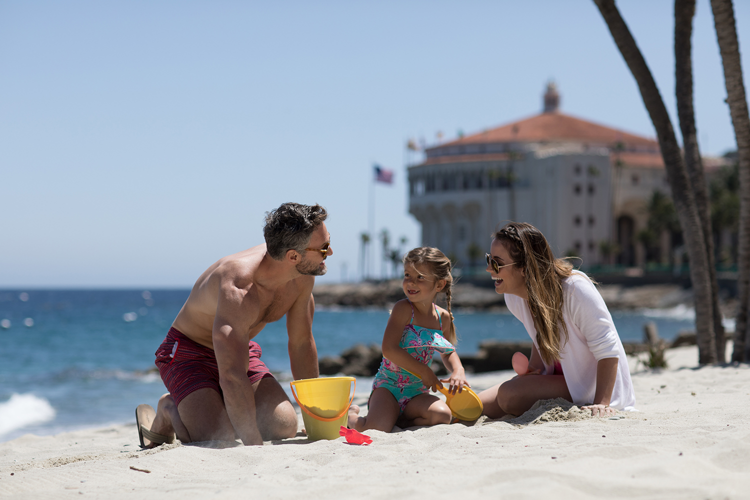 young family playing in the sand at Descanso Beach.