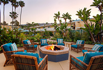 Pavilion Hotel's patio with plush lounge chairs and firepit