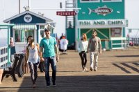Couple walking on the Green Pleasure Pier