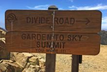 Wooden sign pointing people to the Garden in the Sky Summit.