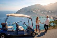 Couple Admiring the View of Avalon Harbor from a Golf Cart